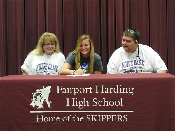 Brenna Lorek signs her commitment letter to Notre Dame College